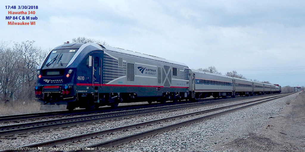 Charger 4610 shoves Hiawatha 340 back to the Windy City