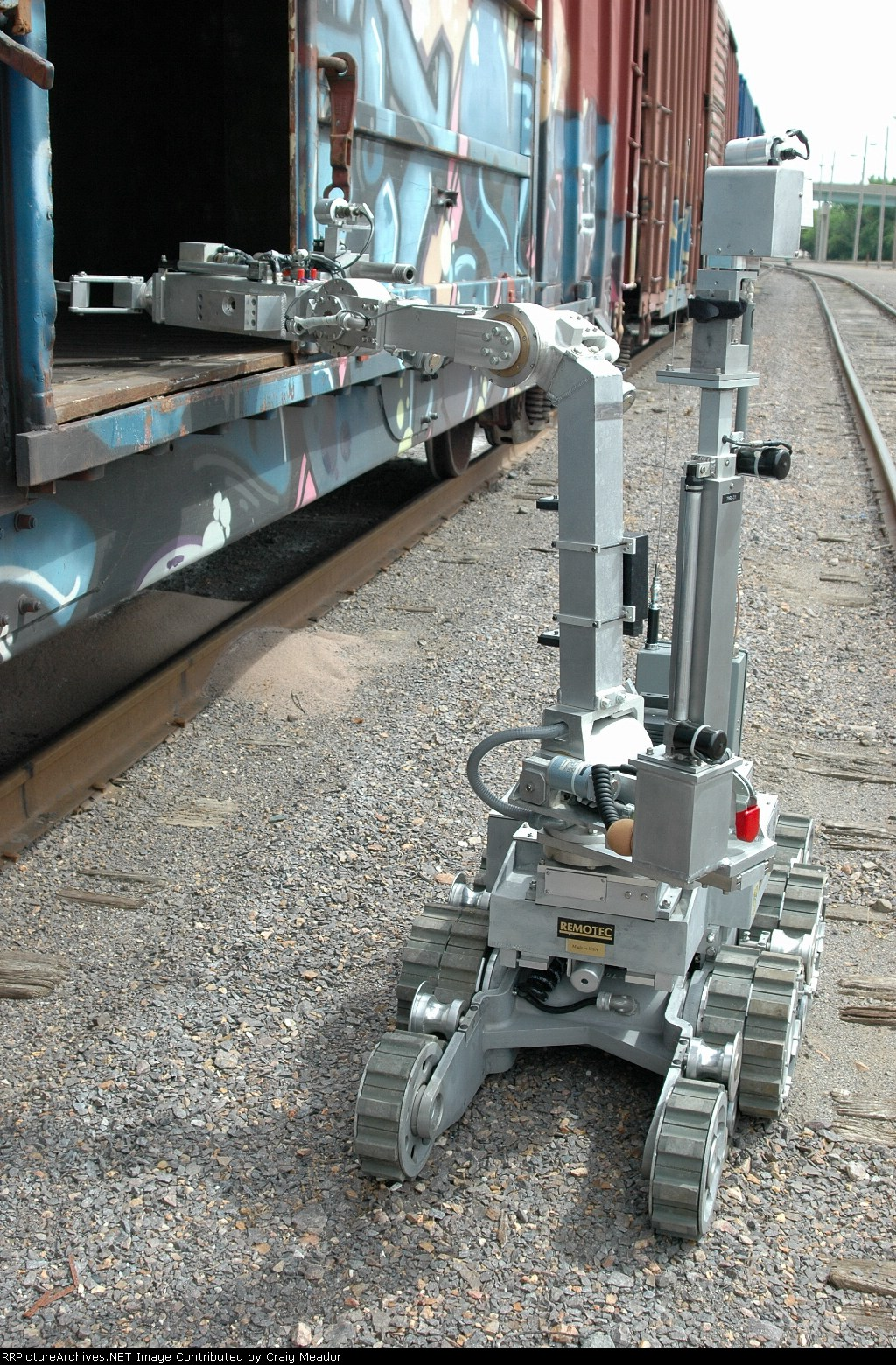 The bomb team robot peeking into a boxcar