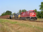 CP 8833 passes its train