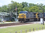 CSX 351 leads a loaded coal train through town