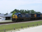 CSX 306 leads a loaded coal train through town