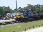 CSX 7844 passes the station with ol Glory flyin behind it