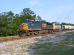 CSX 5221 leads a grain hopper train into town