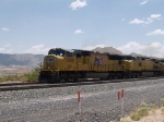 UP 3906 leads a WB autorack at 12:15pm