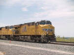 UP 7679 leads an EB doublestack at 1:04pm