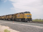 UP 7862 leads an EB manifest MWCOA-26 at 12:39pm
