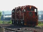 EJ&E pwr backing onto a coal train @ Eola