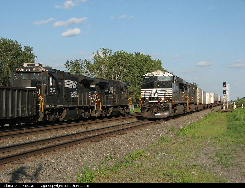 A westbound freight passes the local