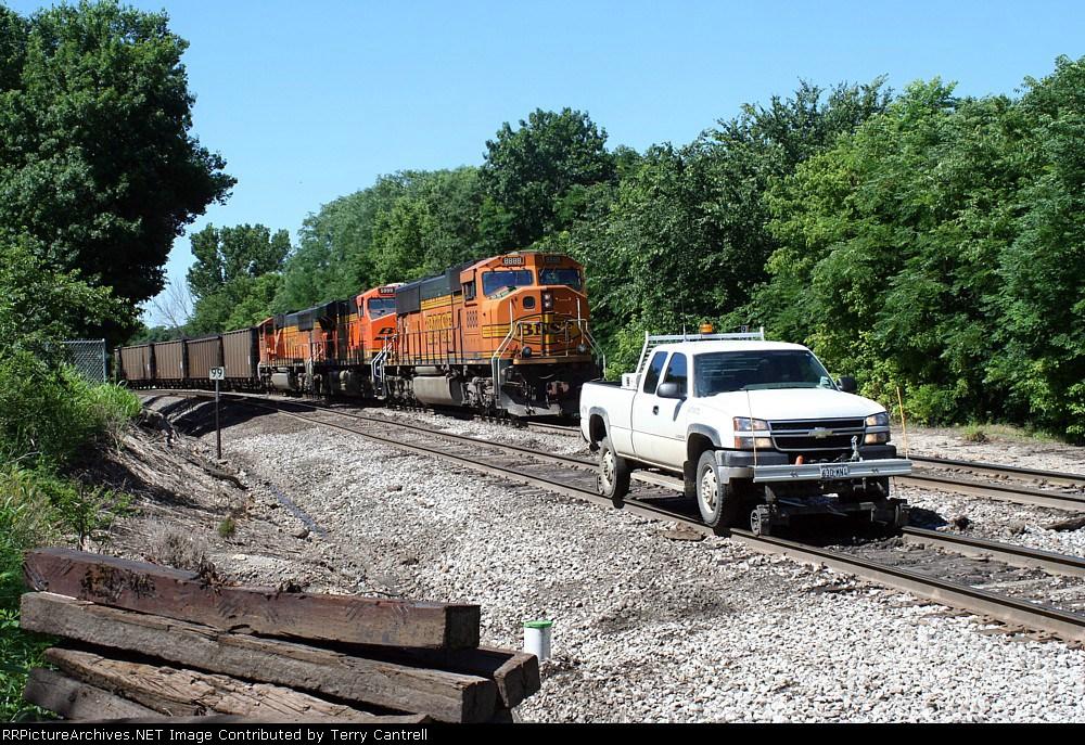 BNSF 8888 passing hi-railer