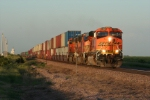 BNSF 7780 with its S-train in tow is a very welcome sight to a coal line.