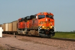 BNSF 5752 leads it WB drag into the setting sun