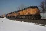 """UP 6539 showing fire damage and minus """"Union Pacific"""" on its flanks, heads an Eastbound through Cheektowaga,NY"""