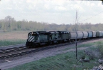 1279-14 Eastbound BN freight passes abandoned ex-GN Cedar Lake Yard