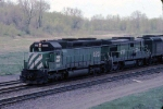 1279-15 Eastbound BN freight passes abandoned ex-GN Cedar Lake Yard