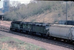 1279-16 Eastbound BN freight passes abandoned C&NW (ex-M&StL) Cedar Lake Yard