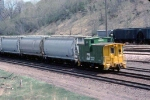 1279-17 Eastbound BN freight passes abandoned C&NW (ex-M&StL) Cedar Lake Yard