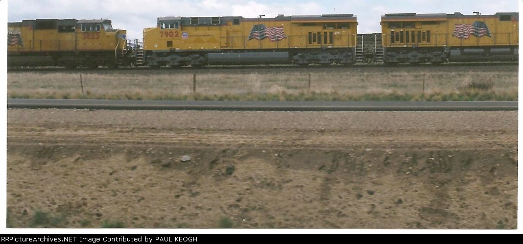 UP 7902 rolls west behind UP 7807 on her first ride west.