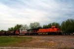 "BNSF C44-9W 627 and ES44DC 7685 push the ""worm"" west."