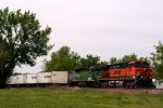 BNSF C44-9W 1036 and SD40-2 7810 head east with a Triple Crown roadrailer train.