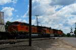Here's a away shot of BNSF C44-9Ws, 4123, 4486, and 4484 as they hit the 11th Street crossing