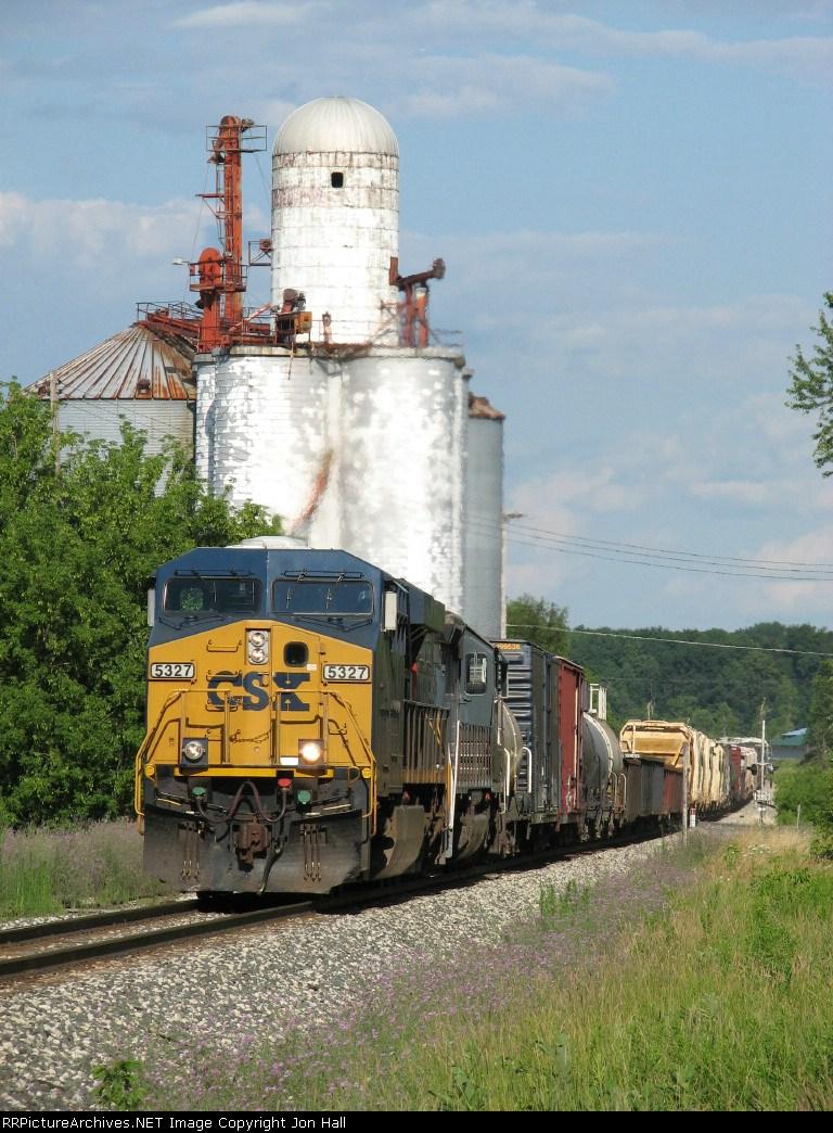 CSX 5327 leads Q335-23 past the old grain elevator