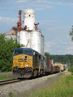 CSX 5327 leads Q335-23 past the old grain elevator