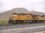 UP 7677 leads a WB autorack at 1:17pm