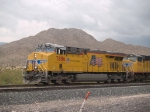 UP 7806 leads a WB doublestack at 1:36pm