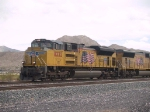 UP 8332 leqds a WB doublestack at 1:12pm