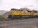UP 8641 leads a WB doublestack at 1:48pm