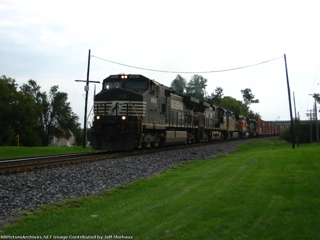 NS 8969 leads a long mixed freight towards Kansas City.