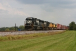 NS 6638 Westbound mixed freight cruises at a steady 45mph towards KC with radioactive cars at the end of train at mp 47.