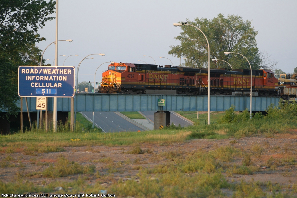 A Ballast Train Makes Its Way Across a Bridge Still Marked for the Burlington Northern