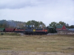 A DMVW Grain Train with Typical GP35 Power Passes a Farm
