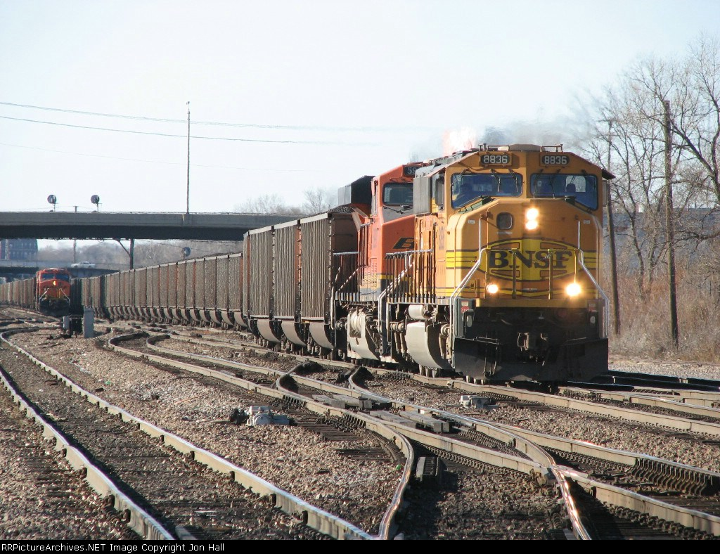 BNSF 8836 & 5997 bring another coal train east as yet another waits in the distance