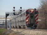 Inbound Rock Island District train 506 rolls under the signals