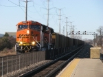 Brand new BNSF 6243 leads more eastbound coal loads