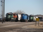 The West Yard job pulls up beside other waiting units