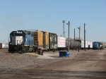 EMDX 785 pulls over 30 cars out of the West Yard