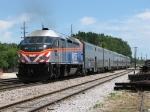 METX 411 shoves its 6 car train east