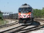 METX 408 shoves its inbound train