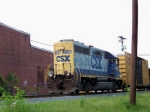 CSX 6057 running long nose first leads northbound local past former Honey Krust bakery 5/2/08
