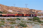 BNSF 900 at the point, with 2 incompletely painted brand new Dash9s