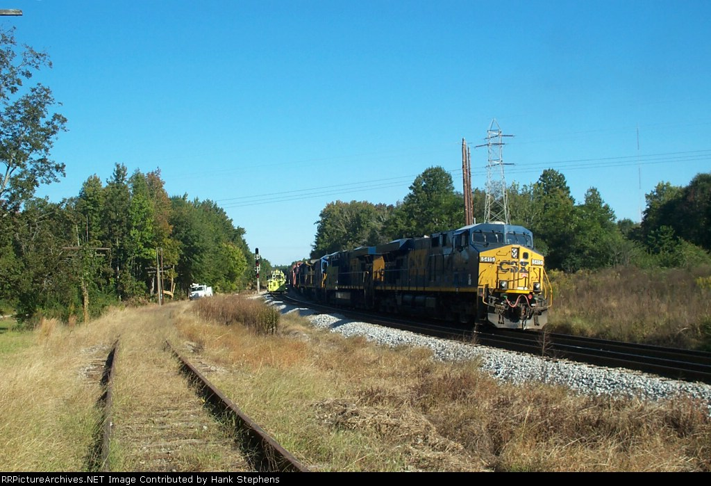 CSX 5415 on a Lineville sub train passes a spot tamping crew at Lafayette Connection in LaGrange