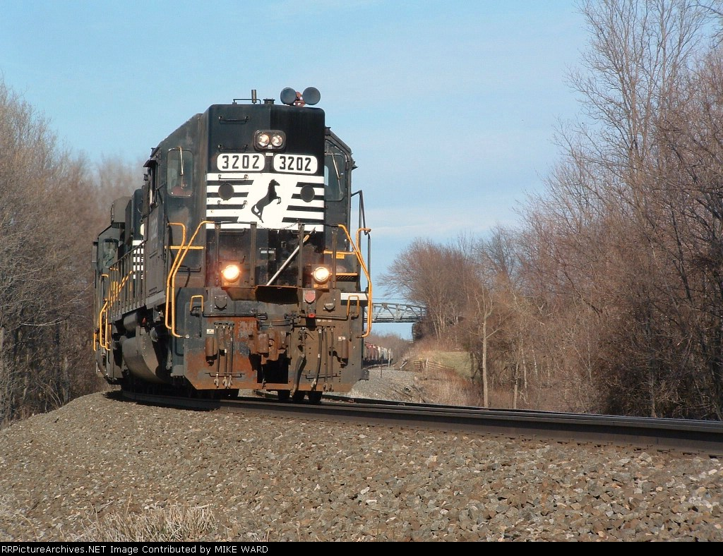 Dynamic brakes screaming, a west bound flys down Attica hill towards town on the old ERIE main
