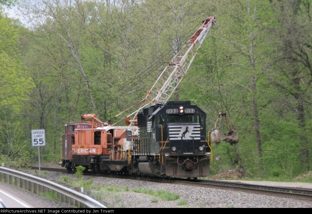 NS 7132 with work train cleaning up a slide at the west end of Moxy tunnel