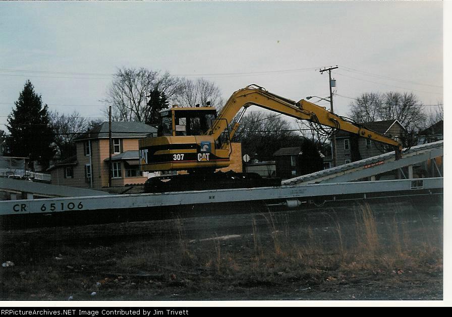 Cat 307 excavator on excavator ramp car