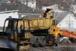 NS dump truck unloading limestone as part of bridge replacment project