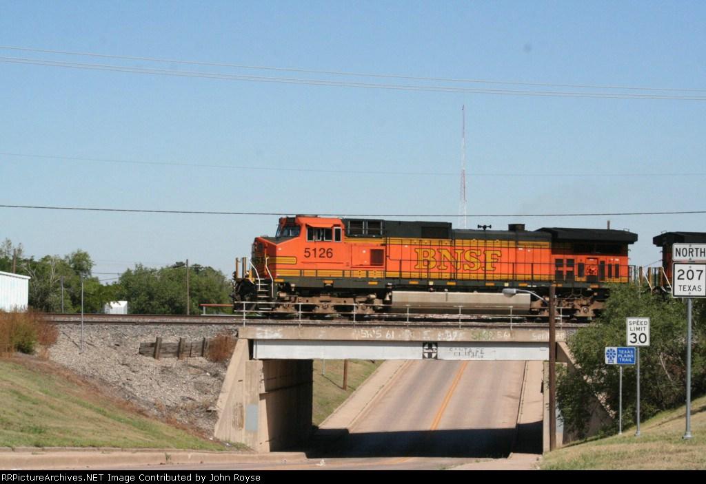 BNSF 5126 over the Texas 207 bridge, note the logo!