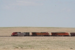 BNSF 4701 leads 3 sytles of BNSF paint schemes EB Yeso